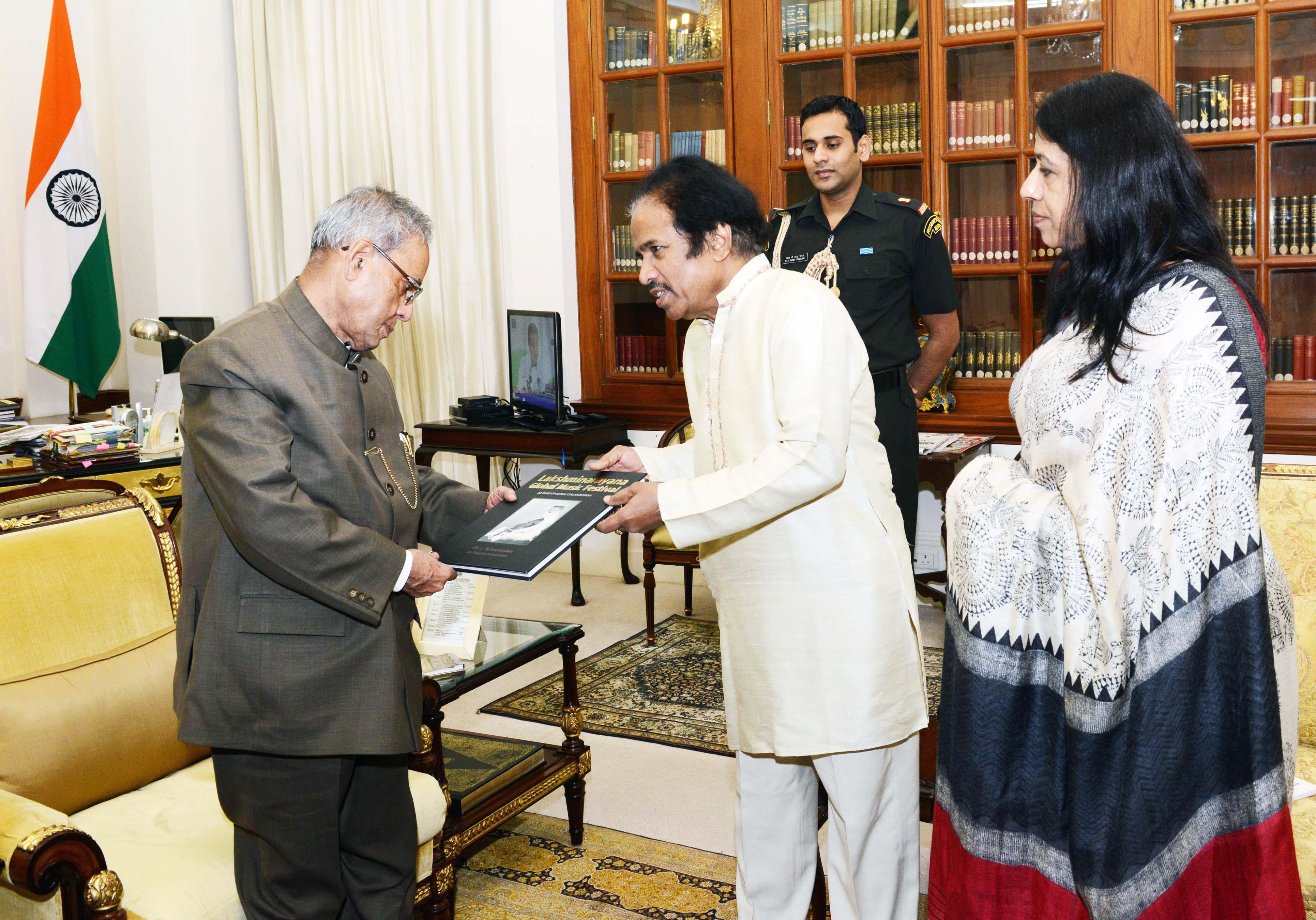President Pranab Mukherjee recieved coffee table book of 20 years