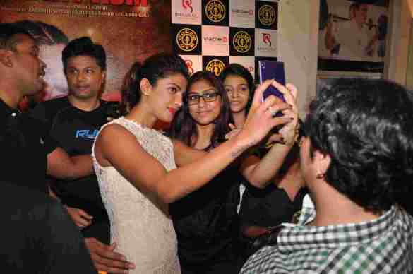 04 Priyanka Chopra clicking selfies with her fans @ Gold's Gym Bandra to promote fitness with the film Mary Kom