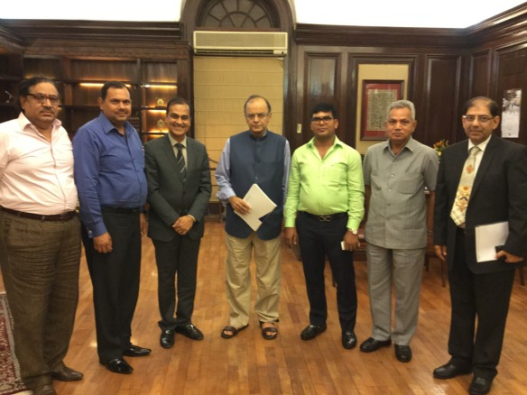 From Left to Right - Mr. Anil Suri, Mr. Dharmender Yadav, Mr. Sunil Mantri, Hon'ble Minister Shi Arun Jaitley, Mr. Sourav Gupta, Brig (Retd.) R.R. Singh, Mr. Manoj Kapoor